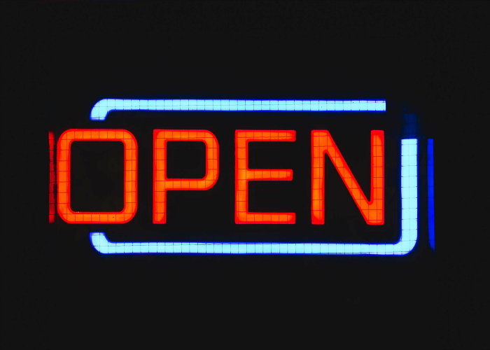 The future of open innovation - a neon open sign.