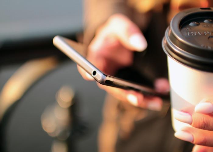 Hand holding phone - Social Media Week Bristol