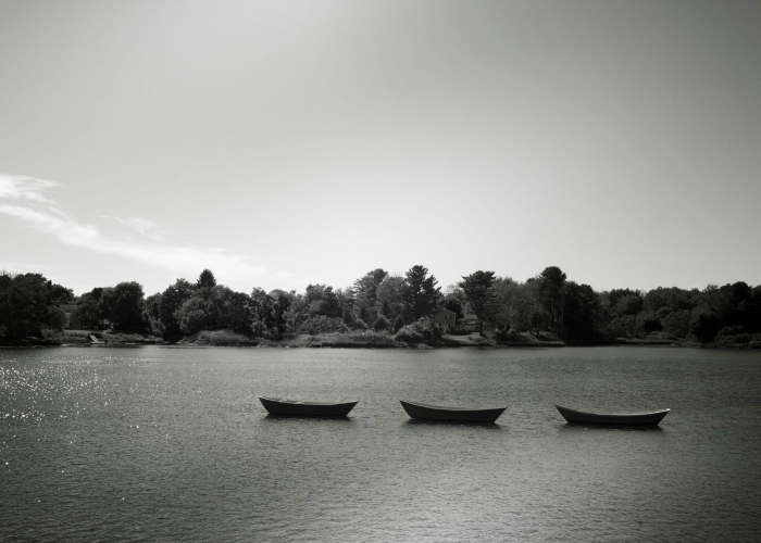 Generating ideas with the rule of three. Three boats on a lake.