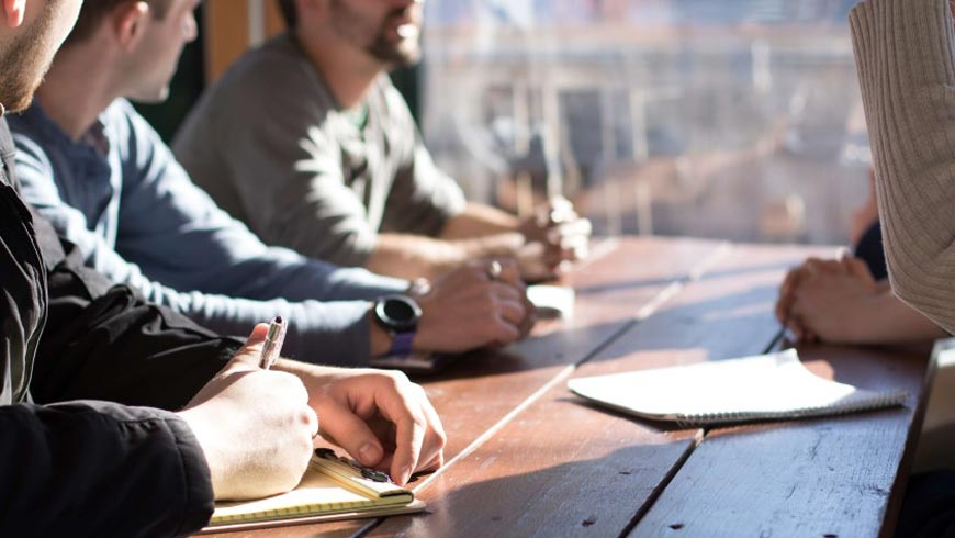 Team meeting, taking notes