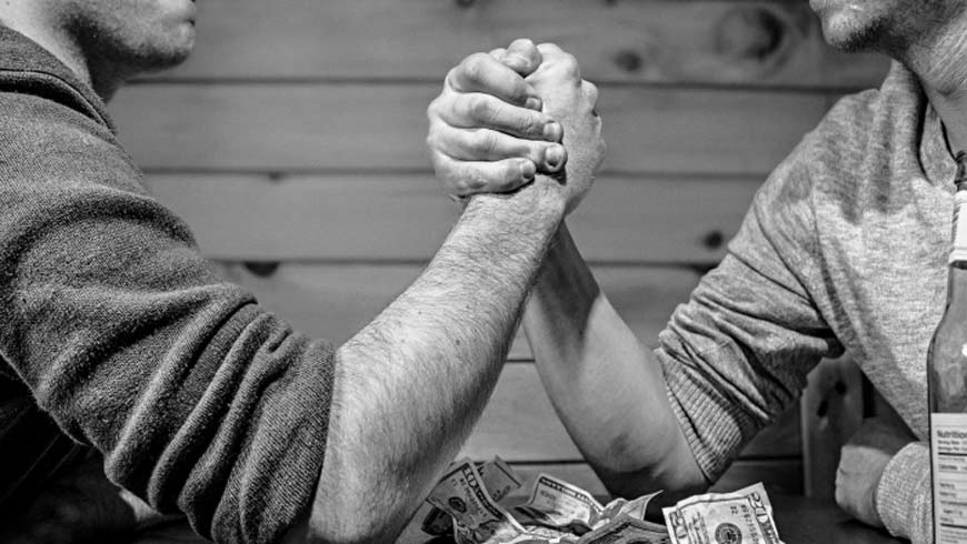 A fair day's pay - two men arm wrestling.